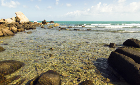 sea waves: sea waves and coral beach with many rocks. summer holiday view