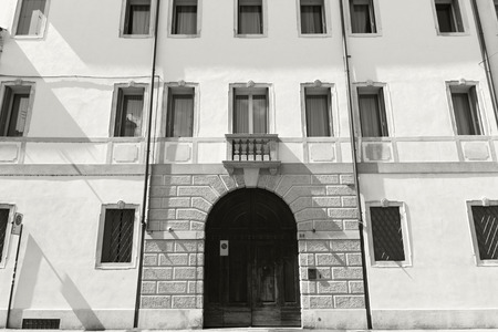 classic Italian building with vintage windows and door. Vicenza city