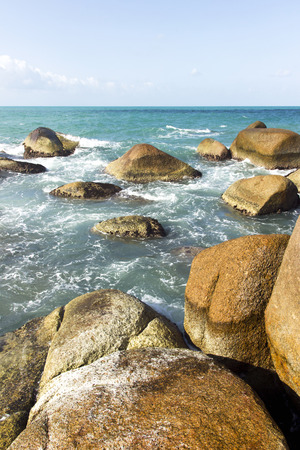 ocean waves, rocks and white water foam. summer nature view