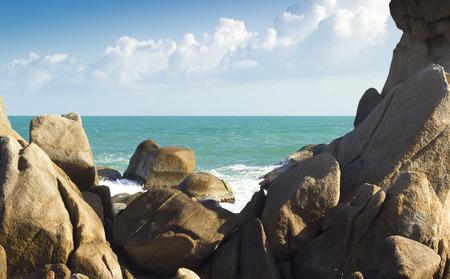 sea waves: sea waves and water splash with white foam. summer ocean between stones