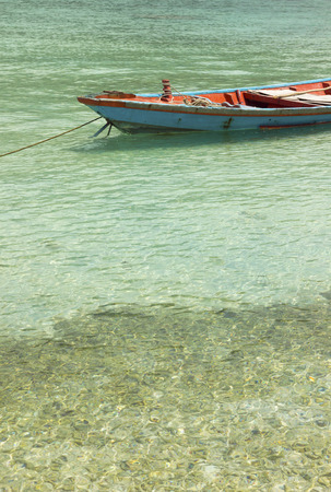 shallop: vintage, wooden boat near peaceful, tropical beach. summer holidays, sea transportation concept Stock Photo