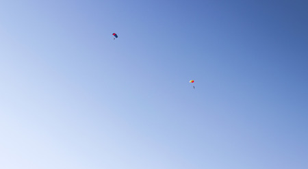 parachutists: a couple of parachutists planing in the blue sky. extreme sports concept Stock Photo