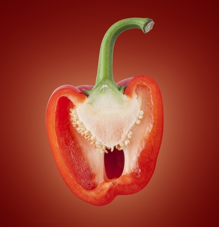 Sliced red bell pepper on a glowing colored background.