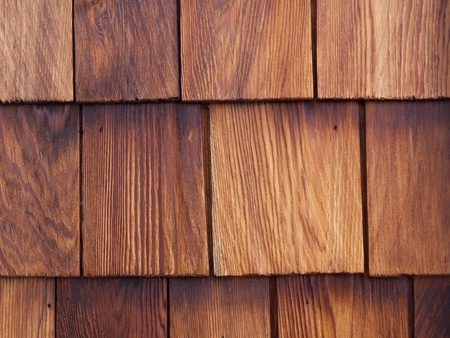 house siding: Detail of a nicely weathered cedar shingle wall.