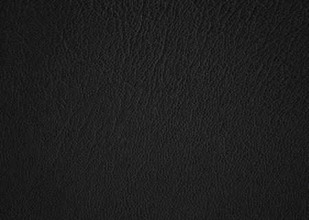 Een gestructureerd detail uit zwart van mijn zoon leren jas. Stockfoto