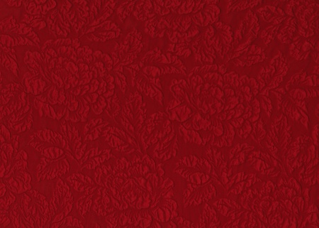 embossed: Red silk material with floral relief pattern.