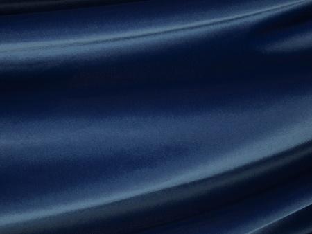 Waves of flowing blue velvet fabric.