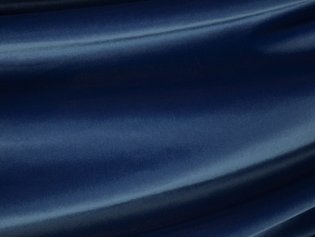 Waves of flowing blue velvet fabric.