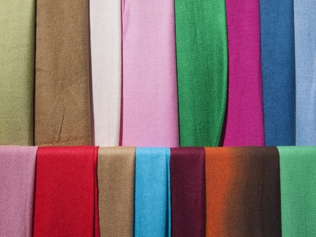 Scarves of many colors on display. Stock Photo
