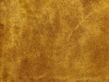 chamois leather: A tanned suede leather background.