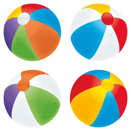 A selection of beach balls in multiple colors isolated on white.