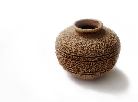 old style handmade ceramic vase with rough suface and ornament