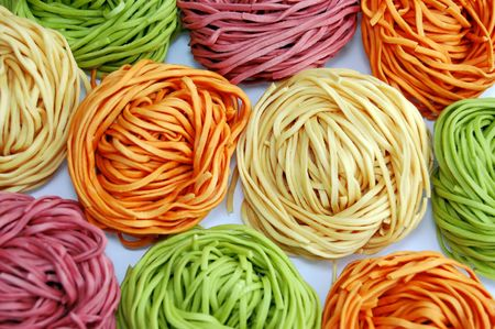 reciept: colored pasta or colored noodles redy for cooking Stock Photo