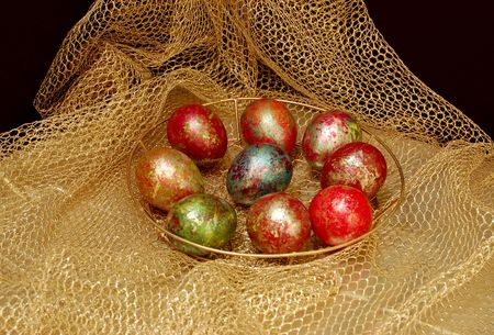 paschal egg in the nest of easter rabbit photo