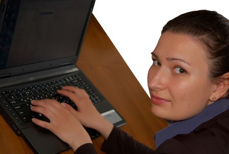 portrait of beautiful brunette women working on laptop (notebook) Stock Photo - 2994560