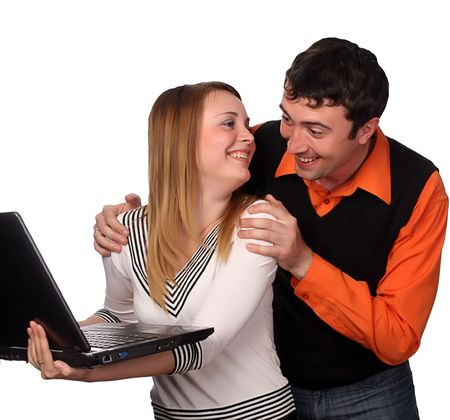 couple having fun with laptop, pretty blonde and handsome young dark haired man photo