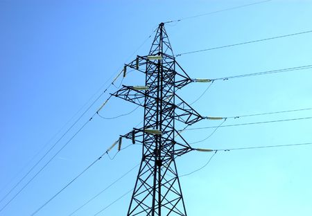 high volts power line on blue sky with insulators and wires photo