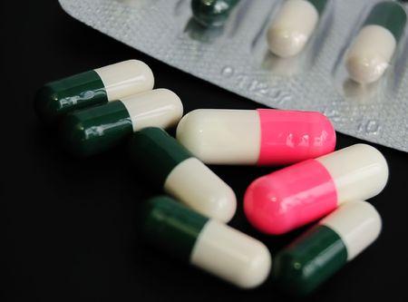 vitamines: drugs or vitamines? seven capsules on black Stock Photo