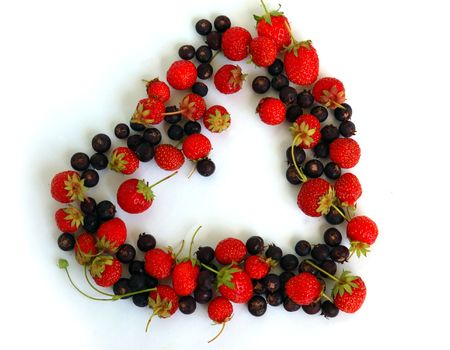 Duality of feelings - heart symbol made of fresh strawberries and bog bilberries