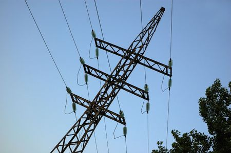 volts: high volts power line on blue sky with insulators and wires Stock Photo