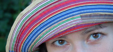 close-up of eyes of attractive young women in colorful hat Stock Photo - 3239023