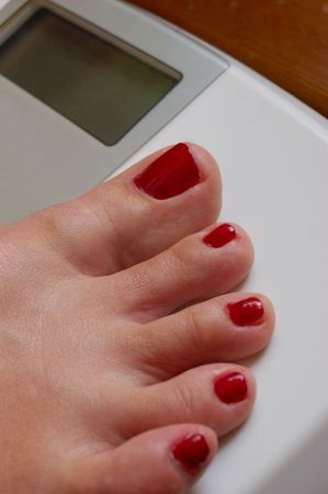 weigher: weigher and female foot Stock Photo