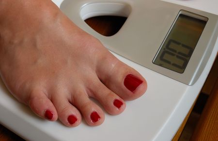 weigher and female foot photo