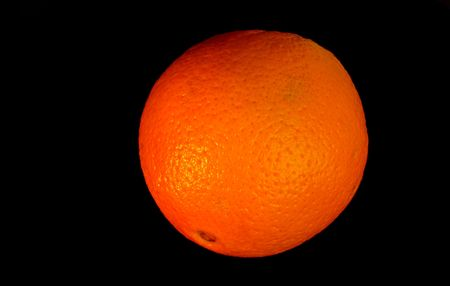 sweet segments: colored orange - isolated on black Stock Photo