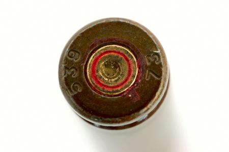 macro of old used 7,62 mm shell (cartrige) of AK47 isolated on white photo