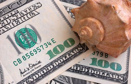 mach: How mach is the summer travel? Close-up of 100 dollar bills and shell Stock Photo