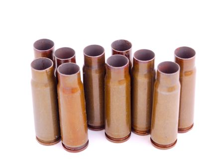 closeup of old used 7,62 mm shells (cartriges) of AK47 isolated on white photo
