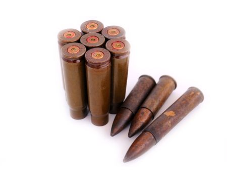closeup of old used 7,62 mm shells (cartriges) of AK47 and bullets of World War I isolated on white photo