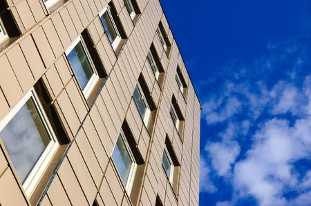 modern office building against sky with clouds Stock Photo - 3499300