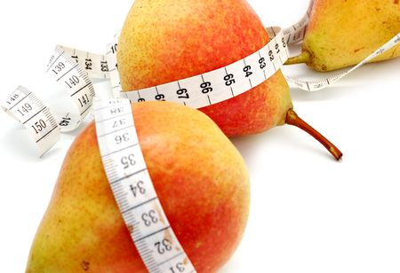 concept of healthy diet - three fresh pears and measuring tape photo