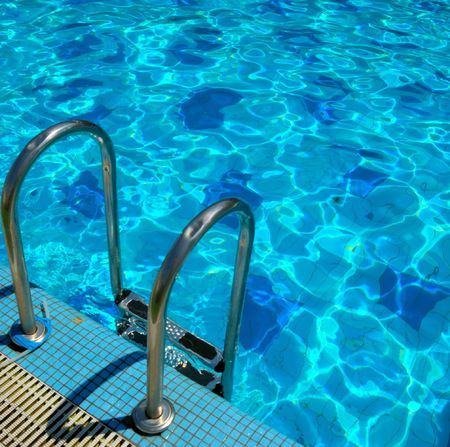 pattern of water of swimming pool with light in it and pool's stairway Stock Photo - 3517700