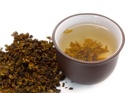 chinese cup of tea and heap of dried green tea (oolong) photo