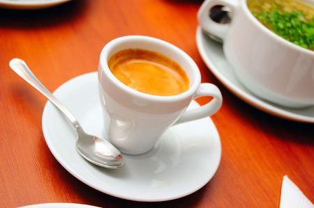 close-up of cup of cofee (espresso), shallow DOF photo