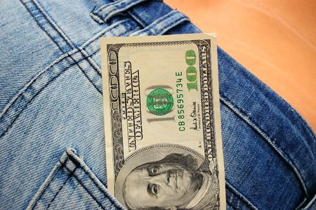close-up of female butt in blue jeans and handred dollar bill Stock Photo - 3535983