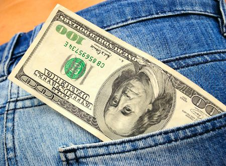sexy business woman: close-up of female butt in blue jeans and handred dollar bill