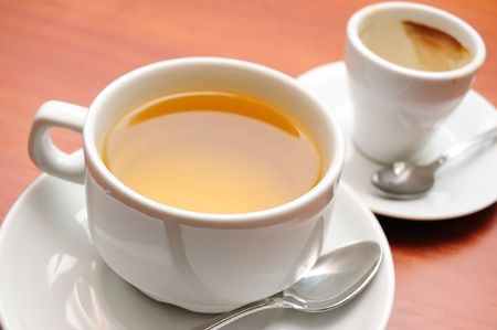 close-up of cup of green tea and empty cap of coffee, shallow DOF photo
