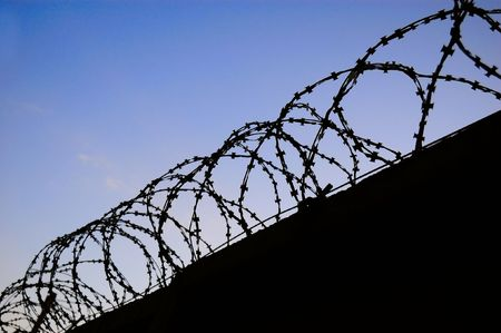 unfreedom concept  - barbed wire over dark wall Stock Photo - 3648792