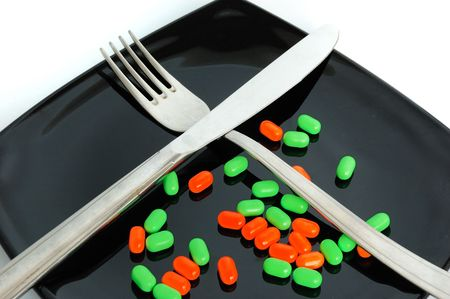 chemical diet - colored pills on black japanise plate Stock Photo - 3737899