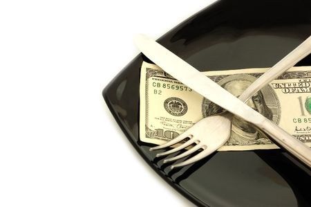expensive food: expensive food concept - black plate and dollars on it