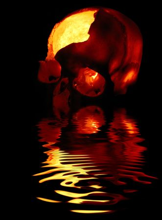 Dark secrets - Old broken skull against black background with inner flame Stock Photo - 3746585