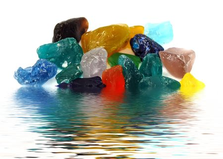 set of colored pieces of glass in water photo