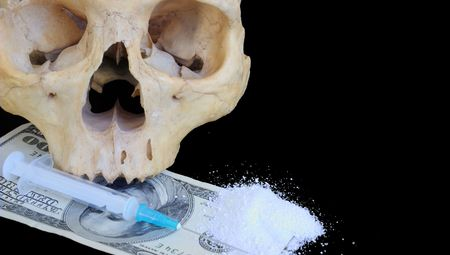 narcomania concept - skull, dollars, syringe, heroin photo