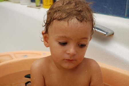 little boy taking a bath photo