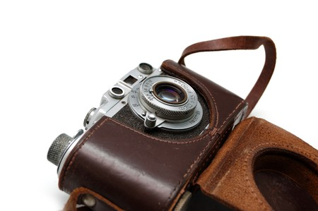 Old rangefinder vintage camera in a leather case against white photo