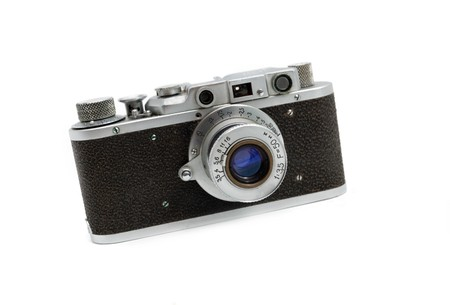 Old rangefinder vintage camera against white photo