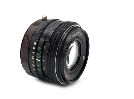 old vintage camera lens against white photo